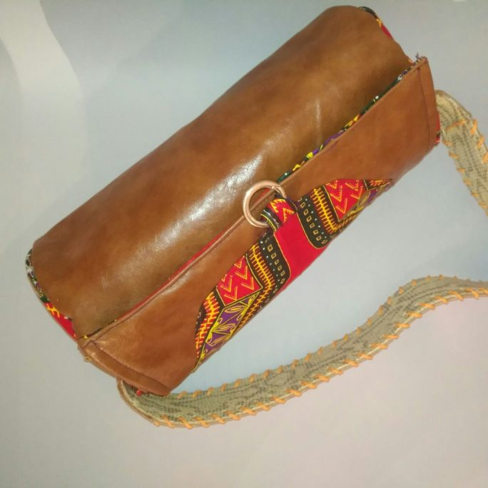 Handmade brown leather purse African fabric flap