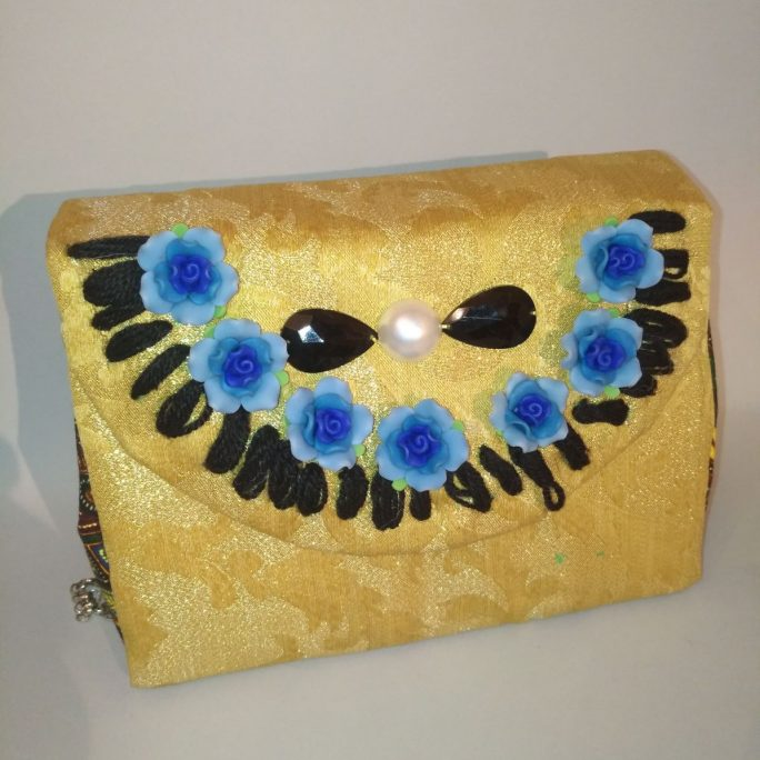 Handmade gold colour fabric purse