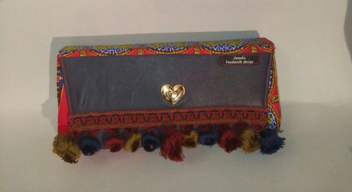 Handmade purse orange African fabric & navy-blue love symbol