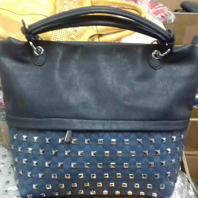 Eliox studded lower leather upper tote bag