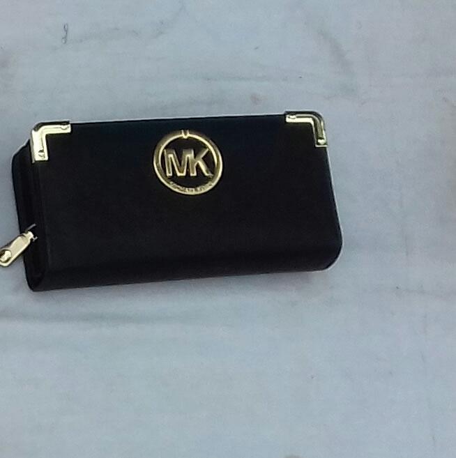 Michael Kors wallet border clasps