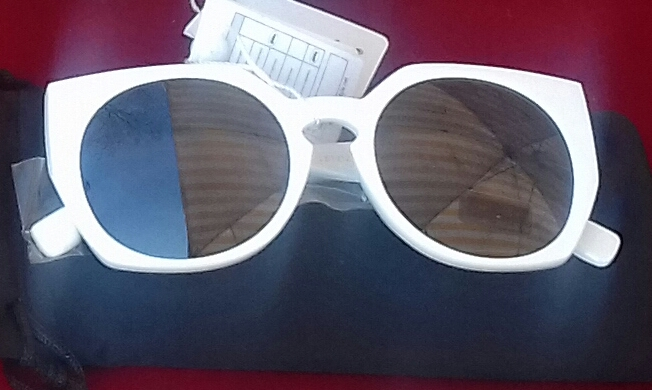 Sunglasses in White Frames